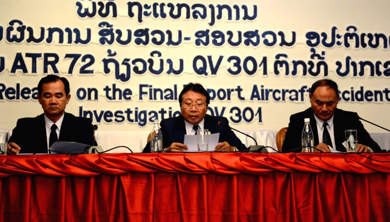 Vientiane (Laos): Lattanamany Kounnyvong (C), deputy minister of Laos Public Works and Transport, reads the final report of aircraft accident investigation of Lao Airlines flight QV301 in Vientiane, .