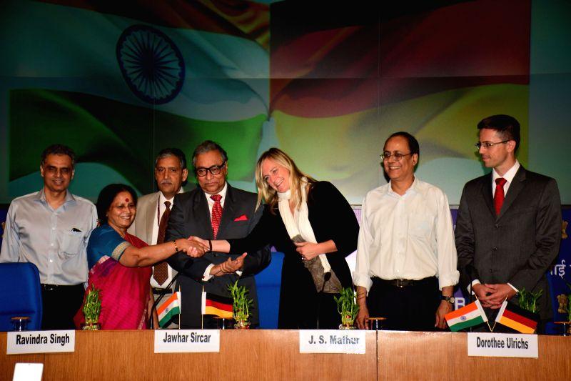 Vijay Laxmi Chabra of Doordarshan and Dorothee Ulrich of Deutsche Welle shake hands after signing a Memorandum of Understanding (MOU) between Prasar Bharati and Deutsche Welle the Public Broadcaster .