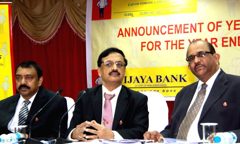 Vijaya Bank Executive Directors BS Rama Rao and K Ramadas Shenoy with banks CMD V Kannan during a press conference in Bangalore on May 6, 2014. - Rao