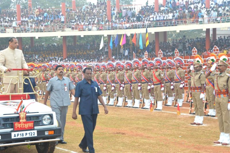 Andhra Governor ESL Narasimhan inspects guard of honour during Republic Day celebrations in Vijayawada on Jan 26, 2015.