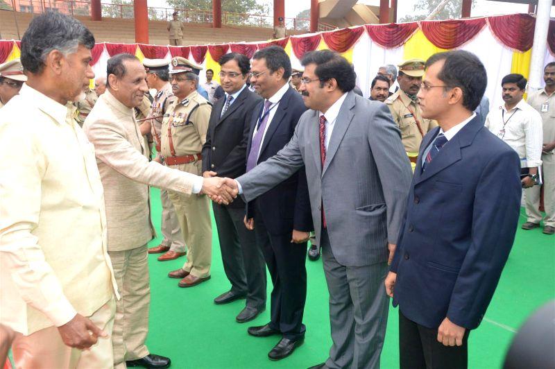 Andhra Pradesh Chief Minister N. Chandrababu Naidu and Andhra Governor ESL Narasimhan during Republic Day celebrations in Vijayawada on Jan 26, 2015. - N. Chandrababu Naidu