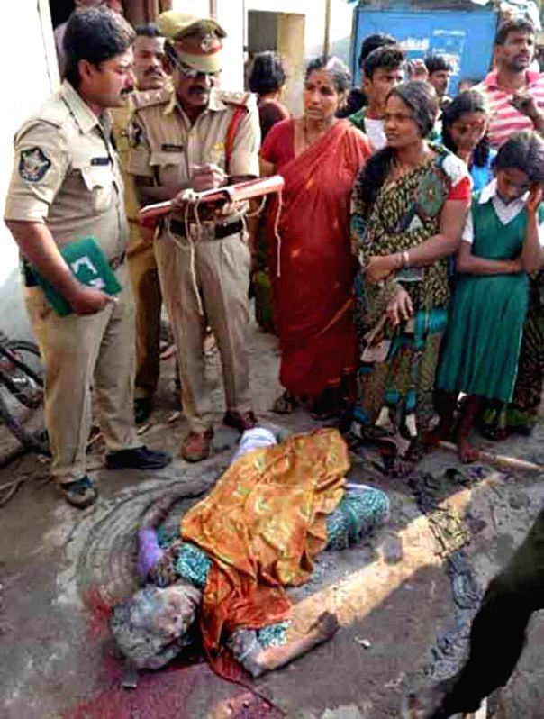 Policemen carry out investigations at the site where  a gas cylinder exploded killing three people in Vijayawada, on Jan 20, 2015.