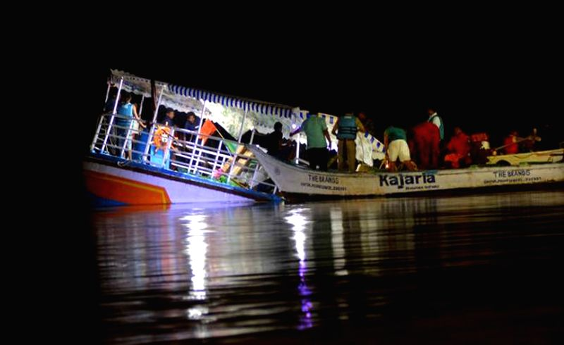 :Vijayawada: Rescue operations underway after 19 tourists, including nine women and two children, were killed and eight others went missing as a boat capsized in the Krishna river on Nov 12, 2017. ...