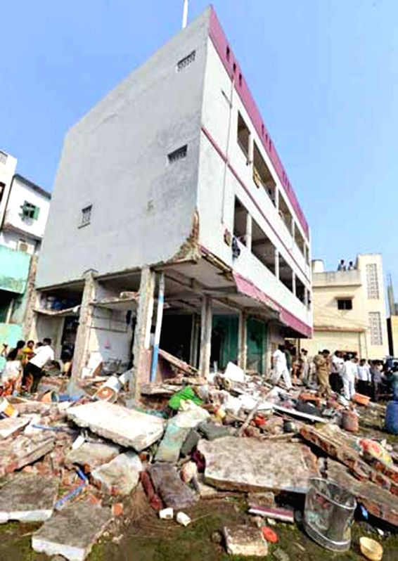 The damaged building where a gas cylinder exploded killing three people in Vijayawada, on Jan 20, 2015.