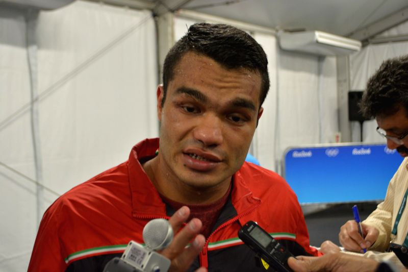 Vikas Krishan Yadav talking to reporters after winning his bout against Charles Conwell of the US in the men\'s Middleweight (75kg) category at Rio Olympics. - Vikas Krishan Yadav