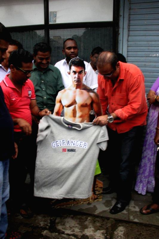 Vile Parle Congress MLA Krishna Hegde arranged to `clothe` the nude posters of Aamir Khan in his forthcoming movie `PK` in Mumbai on Aug. 9, 2014. - Aamir Khan