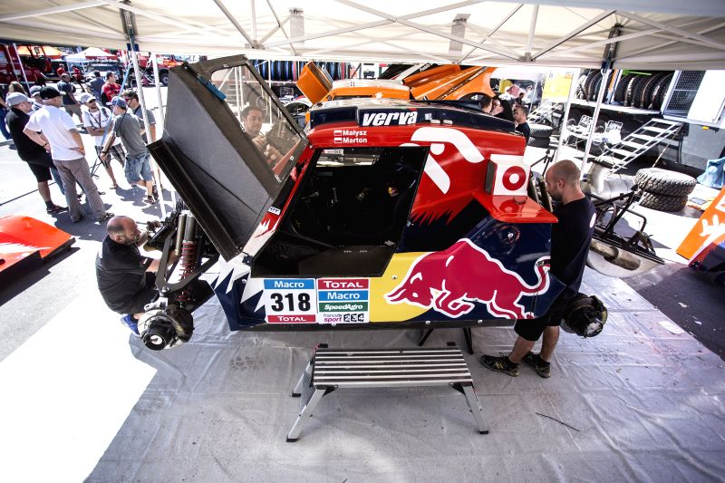 Mechanics work on a vehicle that will compete in the 2015 Dakar Rally, in Tecnopolis, in the town of Villa Martelli, 10km from the city of Buenos Aires, ...