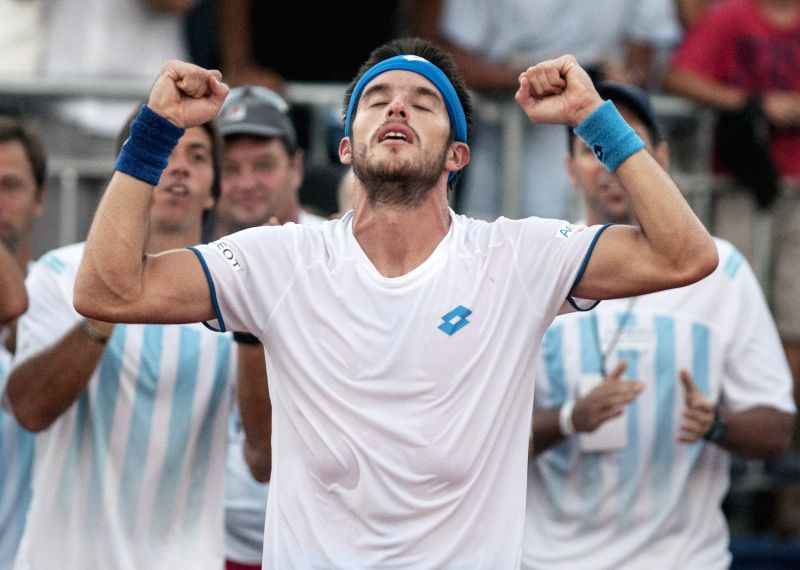 Argentina's Leonardo Mayer celebrates after the Davis Cup World Group first round singles match against Brazil's Thomaz Bellucci in Villa Martelli, near ...