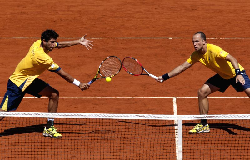 Brazilian players Bruno Soares (R) and Marcelo Melo compete during the Davis Cup world group first round doubles match against Argentina's Carlos Berlocq and ...