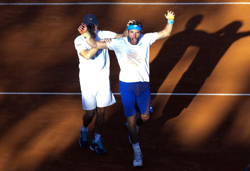 Argentina's Leonardo Mayer (R) celebrates with his captain Daniel Orsanic after the Davis Cup World Group first round singles match against Brazil's Joao ... - Daniel Orsanic
