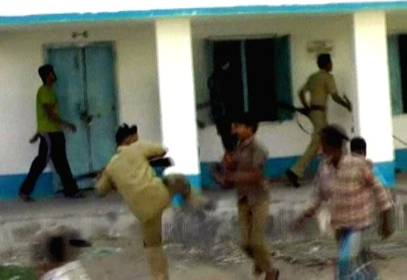 Villagers and police personnel clash following a molestation of a five year old child at Kaliachak in Malda district of West Bengal on April 20, 2014.