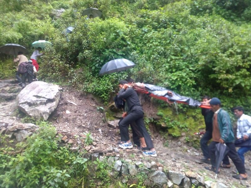 Villagers carry a patient to the nearest community health centre after landslide due to heavy rains at Ghat tehsil in Chamoli district of Uttarakhand on July 17, 2016.