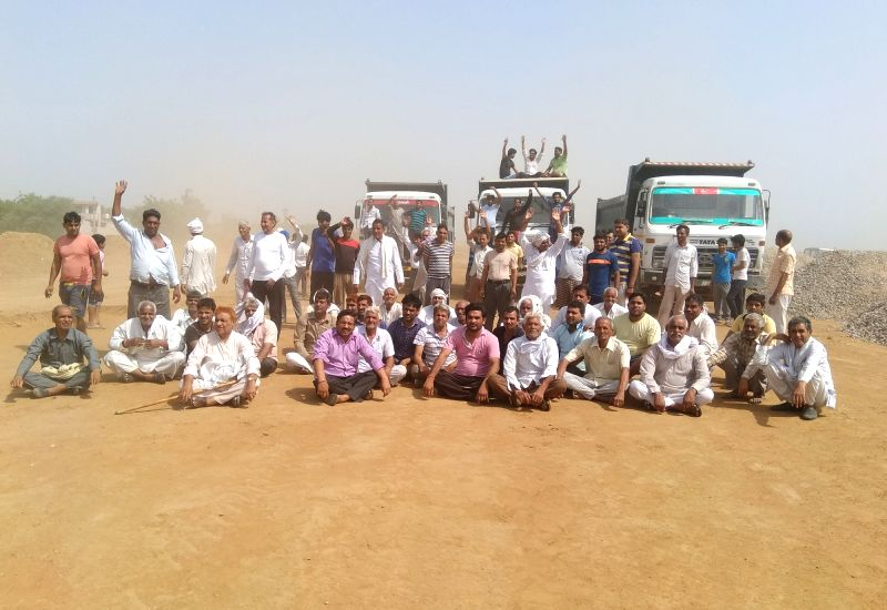 Villagers forcefully stop construction work of KMP Expressway near Pukharpur village in Gurugram on May 28, 2017.