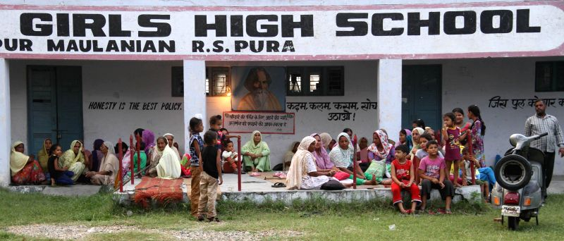 Villagers of Vidhipur border area take refuge in a government school after cross border firing intensified in last few days, in RS Pura sector, 45 km from Jammu on Aug 24, 2014.