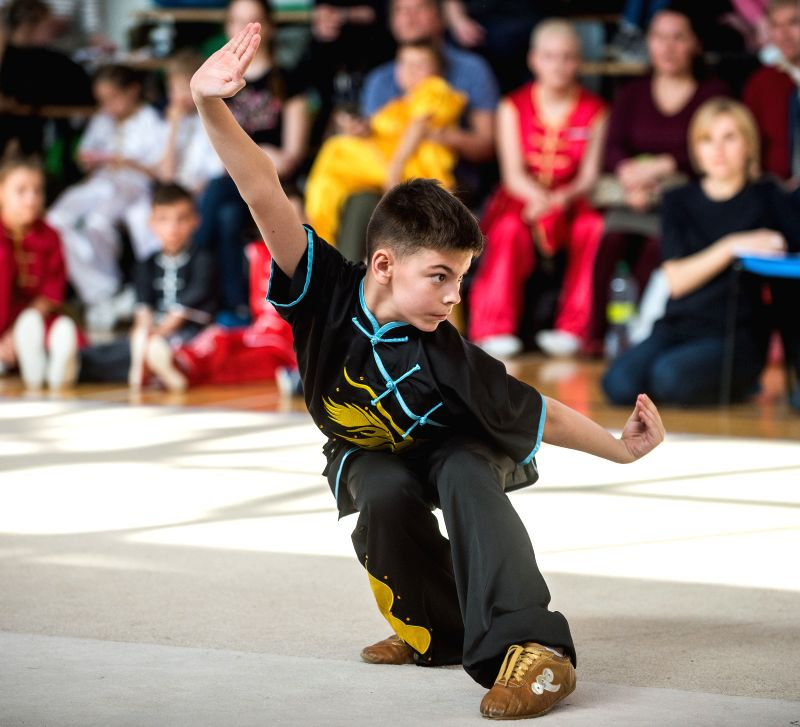 VILNIUS, April 14, 2018 - A young athlete competes at the Fourth Lithuanian Open Wushu Championship in Vilnius, Lithuania on April 14, 2018. Fourth Lithuanian Open Wushu Championship kicked off on ...