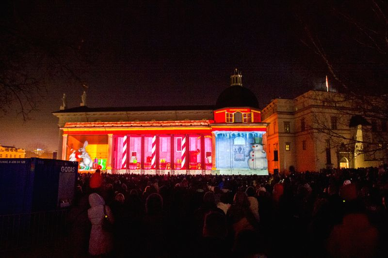 People watch a 3D light show in Vilnius, capital of Lithuania, on Dec. 27, 2014. The ongoing light show lasts from Dec. 25 to 31 celebrating Christmas Day and New ..
