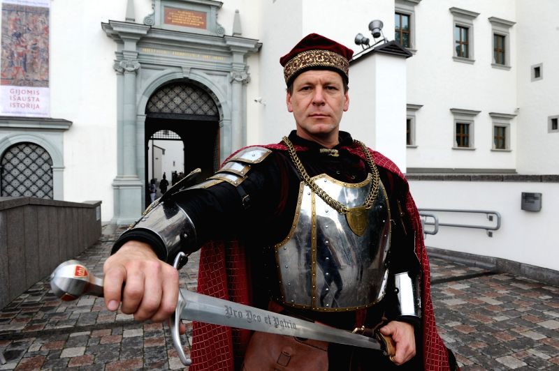 An actor dressing in ancient Lithuania army uniform takes part in the commemoration of the victory in the Battle of Tannenberg in Vilnius, Lithuania, on July 15, ...