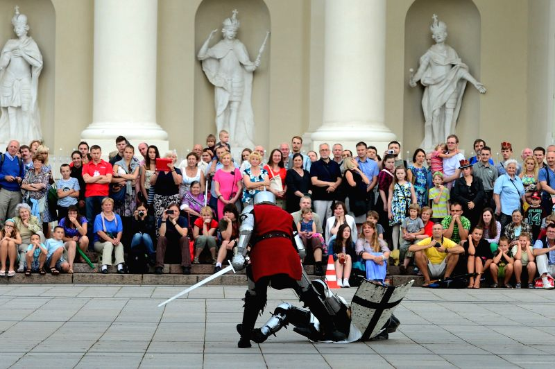People take part in the commemoration of the victory in the Battle of Tannenberg in Vilnius, Lithuania, on July 15, 2014. The Battle of Tannenberg is one of the ...