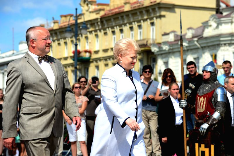Lithuanian President Dalia Grybauskaite (R, front) and Minister of Defense Juozas Olekas (L, front) attend the ceremony of inauguration in Vilnius, Lithuania, on ...