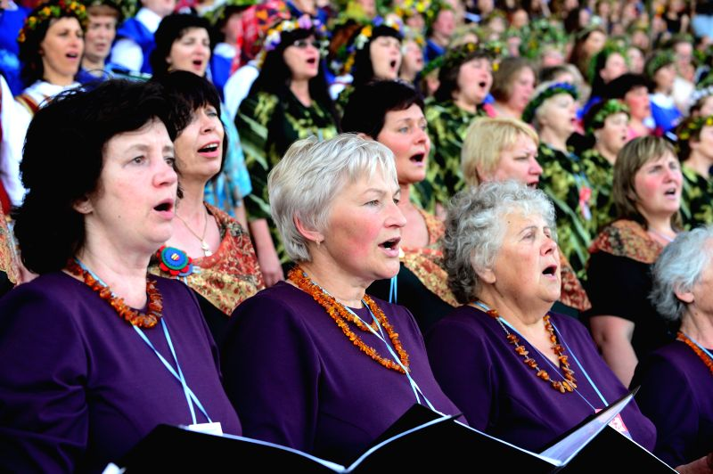 People sing on the Song Day during the 2014 Song Festival in Vilnius, capital of Lithuania on July 6, 2014.