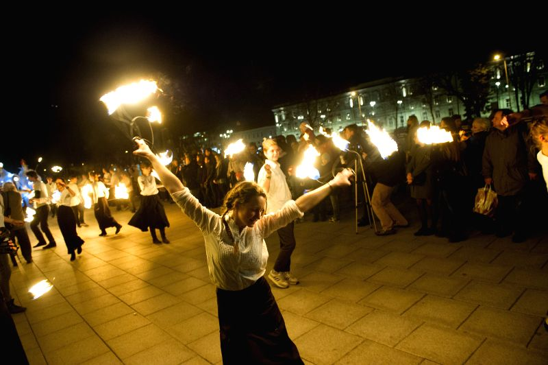 People light fire to celebrate the equinox of spring in Vilnius, Lithuania, on March 20, 2015.