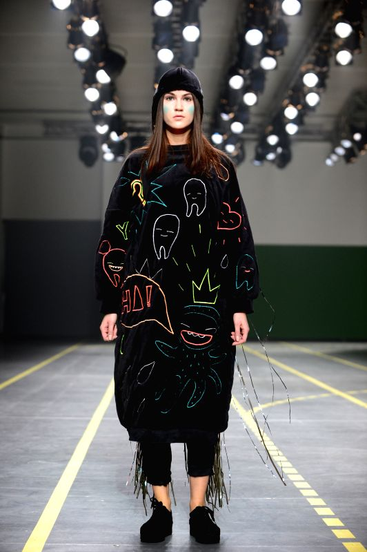A model presents a creation during the international fashion festival in Vilnius, Lithuania, March 27, 2015.