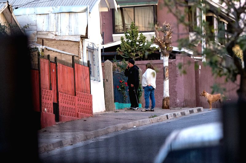 VINA DEL MAR, April 24, 2017 - People stand outside a house after an earthquake in Vina del Mar, Chile, on April 24, 2017. An earthquake measuring 7.1 on the Richter scale jolted 38km West of ...