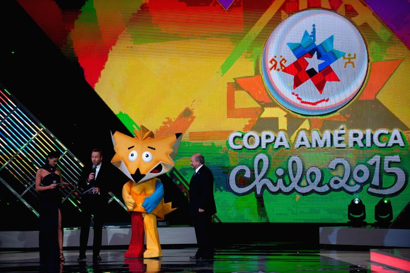 Vina Del Mar (Chile): Executive Director of the Copa America Rene Rosas (1st R) presents the mascot of the Copa America Chile 2015 during the official draw in Vina del Mar, Chile, on Nov. 24, 2014. ..