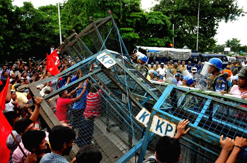Violence erupted between the activists of CPI-affiliated Centre of Indian Trade Unions (CITU) and security personnel during a demonstration against Central Government, in Kolkata on Aug 9, ...