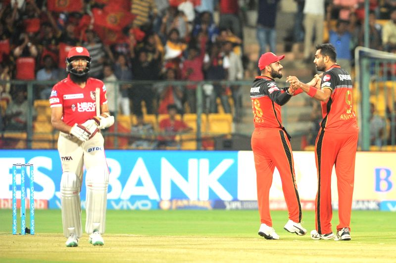 Virat Kohli and Aniket Choudhary of Royal Challengers Bangalore  celebrate fall of Hashim Amla's wicket during an IPL 2017 match between Royal Challengers Bangalore and Kings XI Punjab at ... - Virat Kohli and Aniket Choudhary