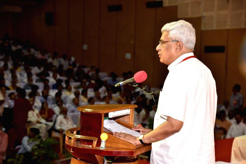 CPI-M general secretary Prakash Karat addresses during party's national conference in Visakhapatnam, Andhra Pradesh on April 14, 2015.