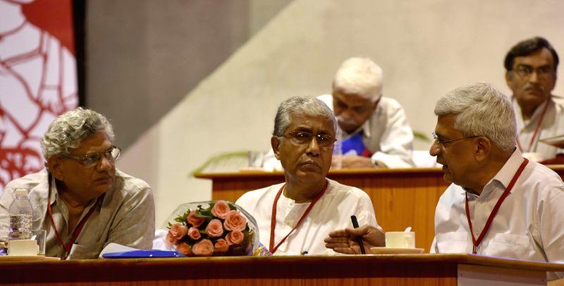 CPI-M general secretary Prakash Karat with CPI-M leaders Sitaram Yechury and Manik Sarkar during party`s national conference in Visakhapatnam, Andhra Pradesh on April 18, 2015. - Sitaram Yechury