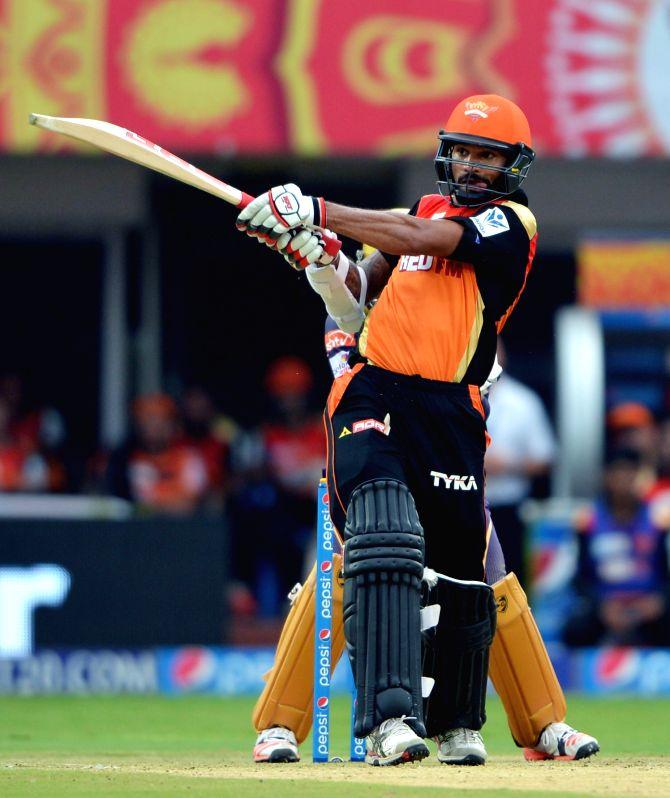 Sunrisers Hyderabad player Shikhar Dhawan in action during an IPL-2015 match between Sunrisers Hyderabad and Kolkata Knight Riders at Dr. Y.S. Rajasekhara Reddy ACA-VDCA Cricket ... - Shikhar Dhawan