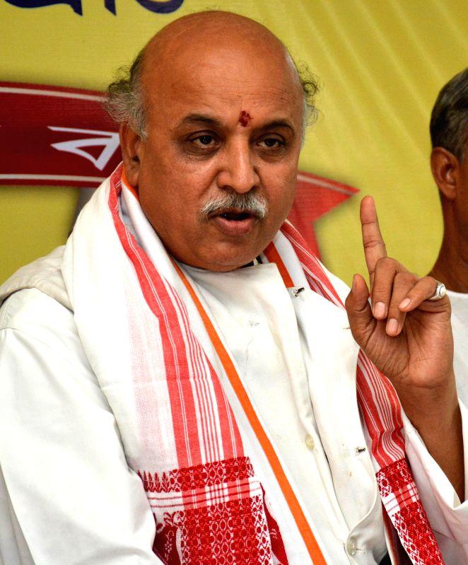 Vishva Hindu Parishad (VHP) chief Pravin Togadia addresses a press conference in Guwahati on July 27, 2014.