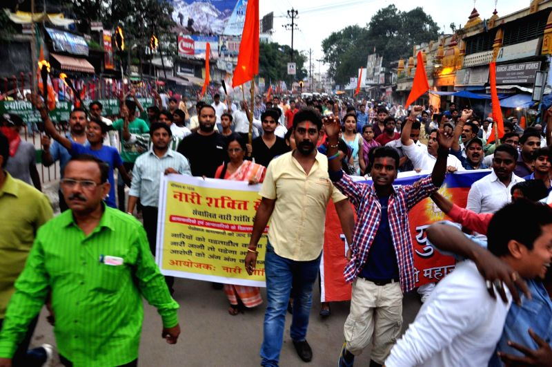 Vishwa Hindu Parishad (VHP) and Bajrang Dal activists demonstrate in support of Tara Sahdeo, a national rifle shooting woman gold medallist who has has alleged that she was tortured to change her ...