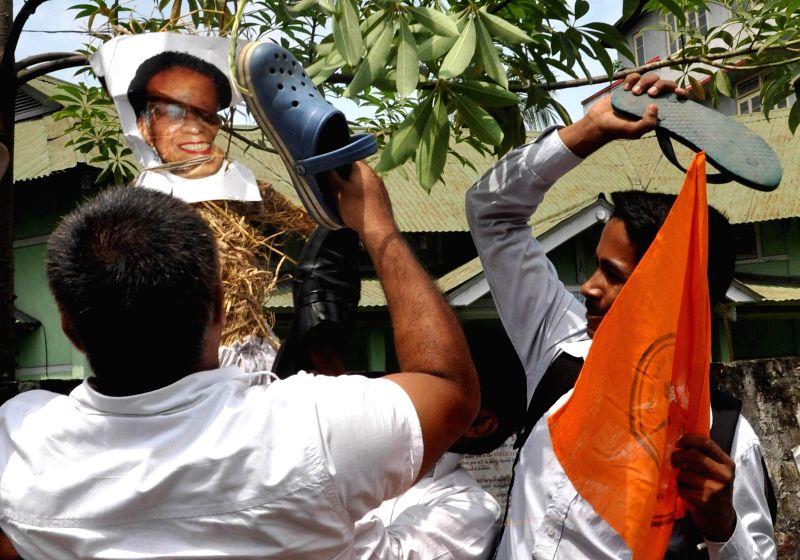 Vishwa Hindu Parishad (VHP) workers demonstrate against Assam Chief Minister Tarun Gogoi against Golaghat violence in Guwahati on Aug 20, 2014. - Tarun Gogoi