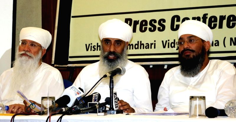 Vishwa Namdhari Sangat Community spokesperson Harpal Singh addresses a press conference regarding the murder of Mata Chand Kaur in New Delhi, on May 16, 2016. - Harpal Singh and Mata Chand Kaur