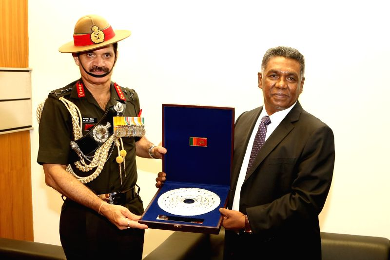 Visiting Indian Army Chief General Dalbir Singh Suhag (L) meets with Sri Lankan Defence Secretary Karunasena Hettiarachchi in Colombo, Sri Lanka, Nov. 30, 2015. The ...