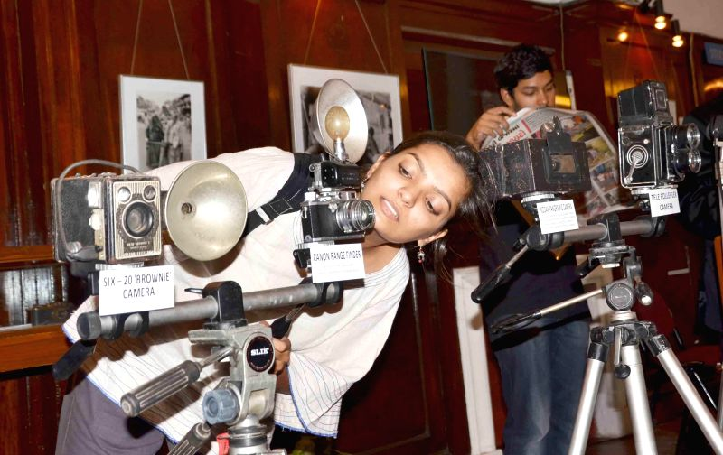 Visitors at 'A Vintage Camera Collection'  a  camera exhibition organised at IGNCA on World Photography Day in New Delhi on Aug 19, 2014.