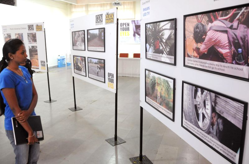 Visitors at `Click Rights` photo exhibition organised by CRY (Child Rights and You) at Chitrakala Parishath in Bangalore on Aug 4, 2014.