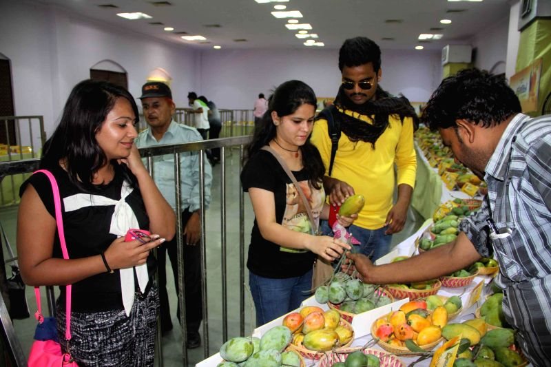 Visitors at the `Mango Festival` organised by Delhi Tourism at Dilli Haat in New Delhi on July 11, 2014.