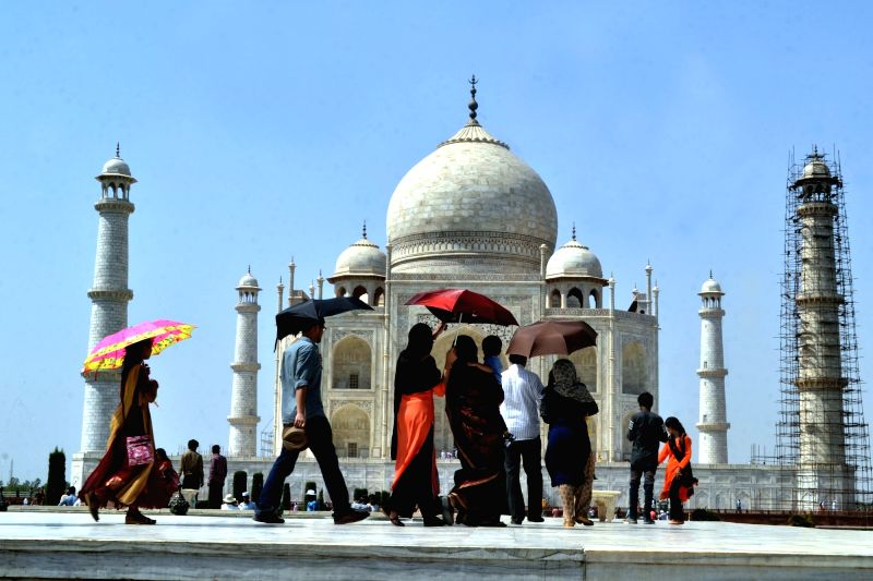 Visitors at the Taj Mahal in Agra on June 4, 2017.