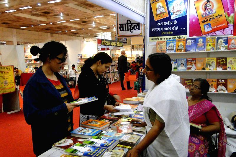 Visitors at the `World Book Fair` organised at Pragati Maidan, in New Delhi, on Feb 14, 2015.