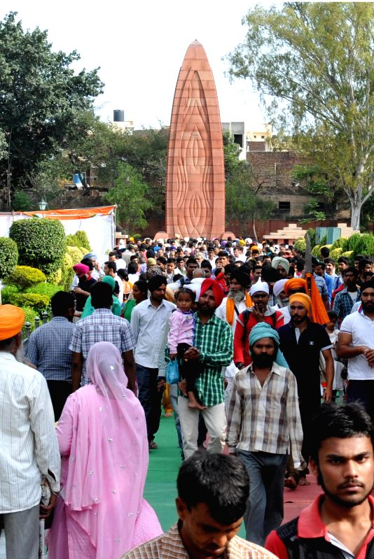 Visitors during a ceremony organised on the eve of Baisakhi to pay tribute to martyrs in Amritsar on April 13, 2014.