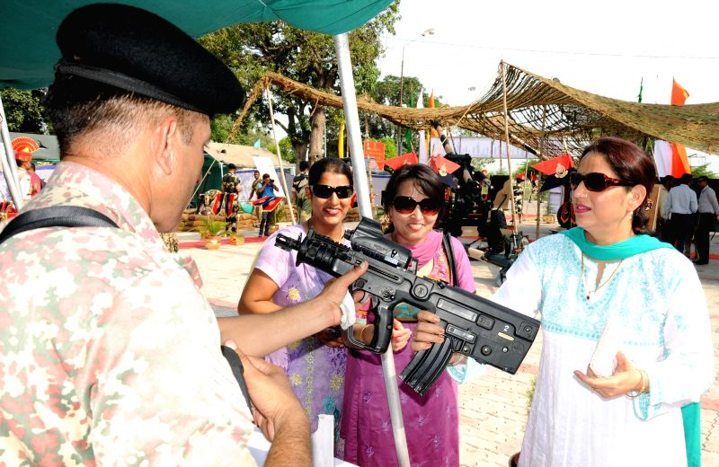 Visitors during an arms exhibition organised by BSF at Attari land border, Punjab ahead of Independence Day on Aug 13, 2014.