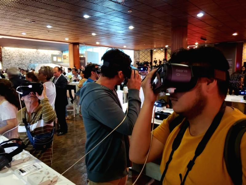 Visitors try a virtual experience of Mexico's ancient city Teotihuacan, produced by Samsung Electronics, at the National Museum of Anthropology in Mexico City on July 25, 2018. The South ...