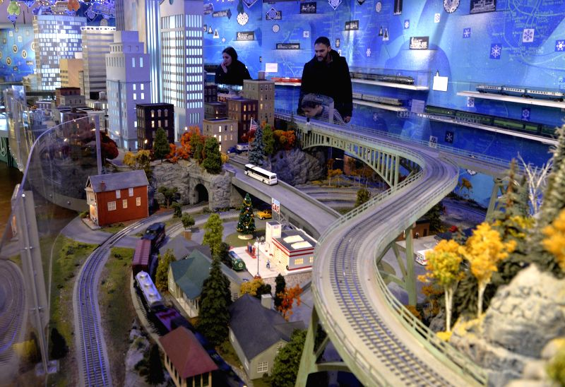 Visitors watch a model railroad presented during the Holiday Train Show at Grand Central in Manhattan, the New York City, the United States, Dec. 9, 2015. Presented ...