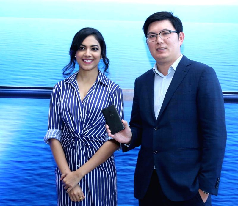 Vivo India CMO Kenny Zeng with actress Ritu Varma at the launch of Vivo - smartphone brand's flagship of the year, V7+ in Hyderabad on Sept 10, 2017. - Ritu Varma