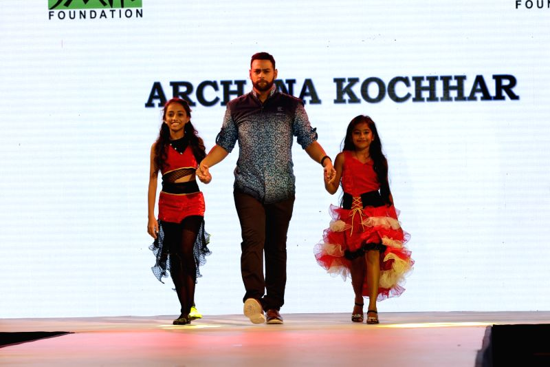 VJ Andy walks the ramp during for 9th edition of charity fashion show organized by Smile Foundation in Mumbai, on August 2, 2015.