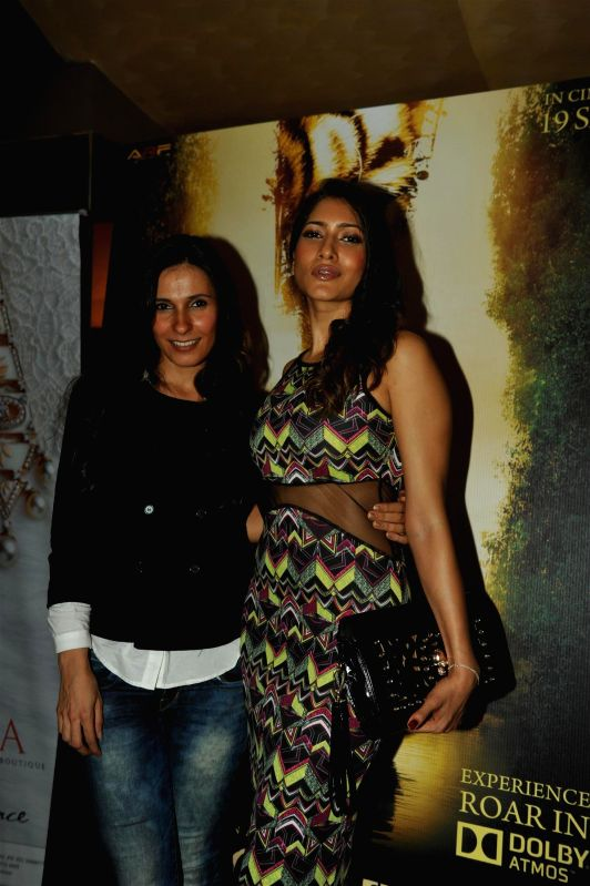 VJ Ramona Arena and Himarsha Venkatsamy during the first look of film Roar in Mumbai, on July 31, 2014.